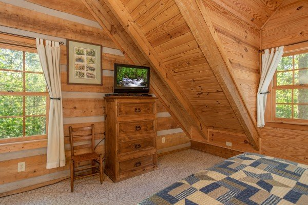 Dresser and TV in the loft bedroom at Trillium Lodge, a 4 bedroom cabin rental located in Gatlinburg