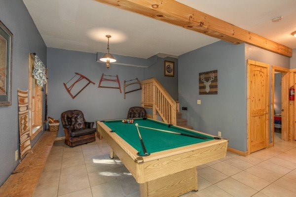 Pool table in the game room at Trillium Lodge, a 4 bedroom cabin rental located in Gatlinburg