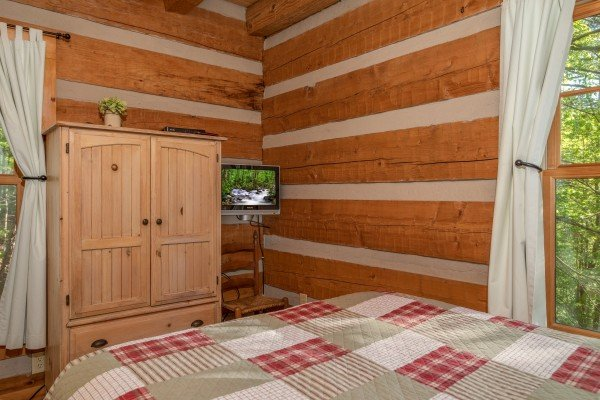 Bedroom with armoire & TV at Trillium Lodge, a 4 bedroom cabin rental located in Gatlinburg