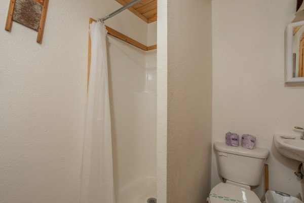 Bathroom with a shower stall at Trillium Lodge, a 4 bedroom cabin rental located in Gatlinburg