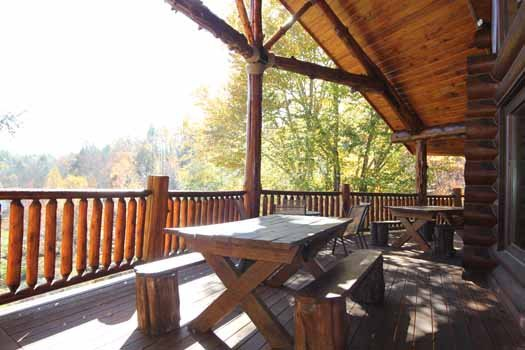 back deck with picnic table at waters edge lodge a 4 bedroom cabin rental located in gatlinburg