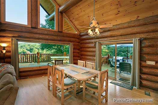 dining room with large windows at waters edge lodge a 4 bedroom cabin rental located in gatlinburg