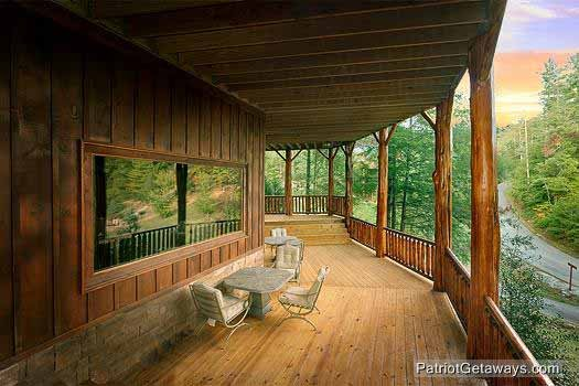 first floor deck with eating area at waters edge lodge a 4 bedroom cabin rental located in gatlinburg