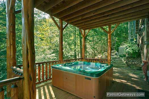 first floor deck with hot tub at waters edge lodge a 4 bedroom cabin rental located in gatlinburg
