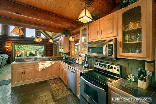 kitchen with stainless steel appliances at waters edge lodge a 4 bedroom cabin rental located in gatlinburg