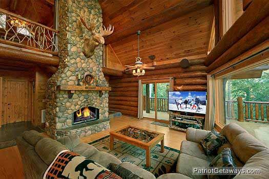 living room with fireplace at waters edge lodge a 4 bedroom cabin rental located in gatlinburg