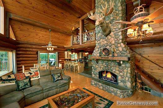 living room with cathedral ceilings at waters edge lodge a 4 bedroom cabin rental located in gatlinburg