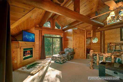 lofted bedroom with king bed and jacuzzi at waters edge lodge a 4 bedroom cabin rental located in gatlinburg