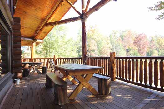 main level deck with picnic table at waters edge lodge a 4 bedroom cabin rental located in gatlinburg