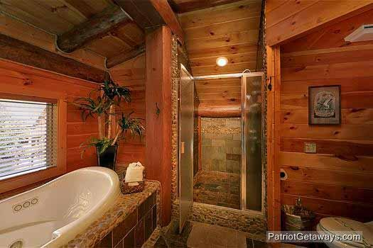 master bath jacuzzi and custom shower at waters edge lodge a 4 bedroom cabin rental located in gatlinburg