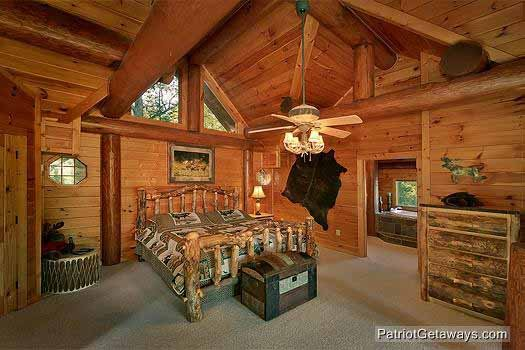 master bedroom with log bed at waters edge lodge a 4 bedroom cabin rental located in gatlinburg