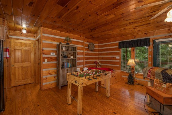Foosball table in the living room at Honey Bear Hideaway, a 1 bedroom cabin rental located in Pigeon Forge