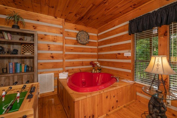 Heart shaped jacuzzi at Honey Bear Hideaway, a 1 bedroom cabin rental located in Pigeon Forge