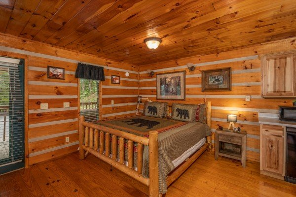 King bed in a studio cabin at Honey Bear Hideaway, a 1 bedroom cabin rental located in Pigeon Forge