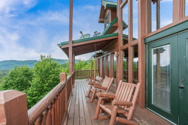 Log rockers on the deck at Mountain Bliss, a 2 bedroom cabin rental located in Pigeon Forge