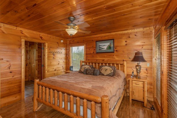 Bedroom with a log bed at Mountain Bliss, a 2 bedroom cabin rental located in Pigeon Forge
