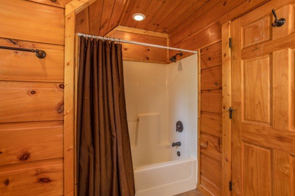 Bathroom with a tub and shower at Mountain Bliss, a 2 bedroom cabin rental located in Pigeon Forge