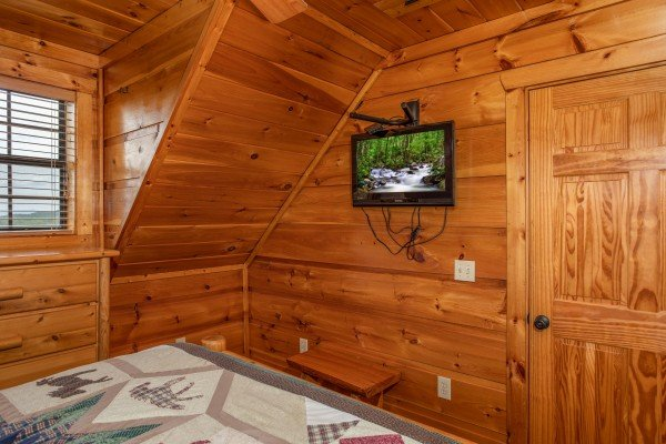 TV in a bedroom at Mountain Bliss, a 2 bedroom cabin rental located in Pigeon Forge
