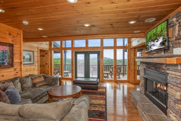 Living room with fireplace and TV at Mountain Bliss, a 2 bedroom cabin rental located in Pigeon Forge