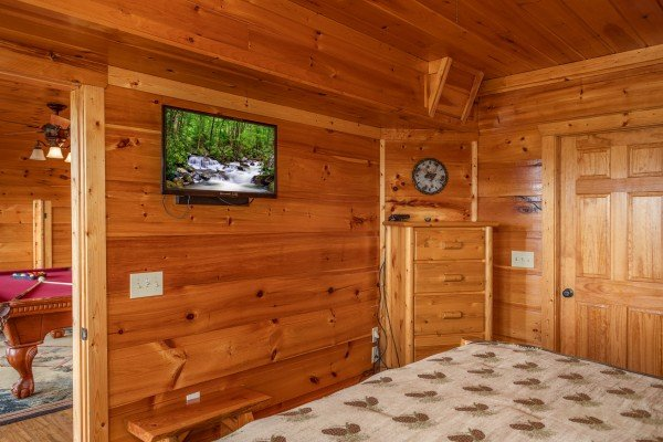 Bedroom with a TV and dresser at Mountain Bliss, a 2 bedroom cabin rental located in Pigeon Forge