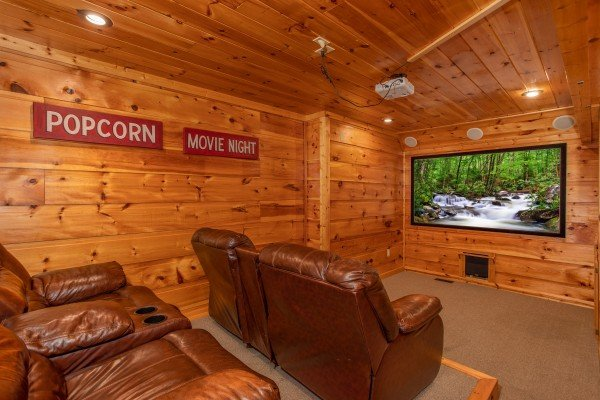 Home theater room with seating at Mountain Bliss, a 2 bedroom cabin rental located in Pigeon Forge