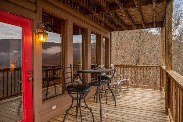 Bistro seating on the deck at 1 Awesome View, a 3 bedroom cabin rental located in Pigeon Forge