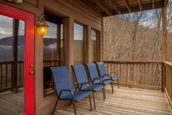 Blue deck chairs at 1 Awesome View, a 3 bedroom rental cabin in Pigeon Forge