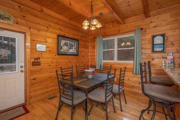 Dining table for six and a breakfast bar at 1 Awesome View, a 3 bedroom cabin rental located in Pigeon Forge