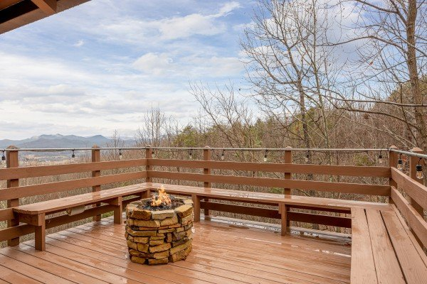Fire pit on the deck at 1 Awesome View, a 3 bedroom cabin rental located in Pigeon Forge