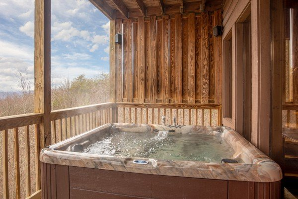 Hot tub on a deck at 1 Awesome View, a 3 bedroom rental cabin in Pigeon Forge