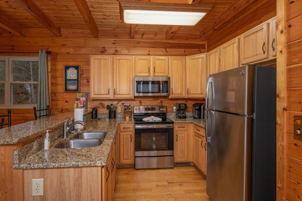 Kitchen with stainless appliances at 1 Awesome View, a 3 bedroom cabin rental located in Pigeon Forge