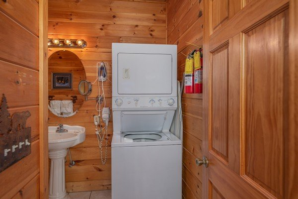 Stacked washer and dryer at 1 Awesome View, a 3 bedroom cabin rental located in Pigeon Forge