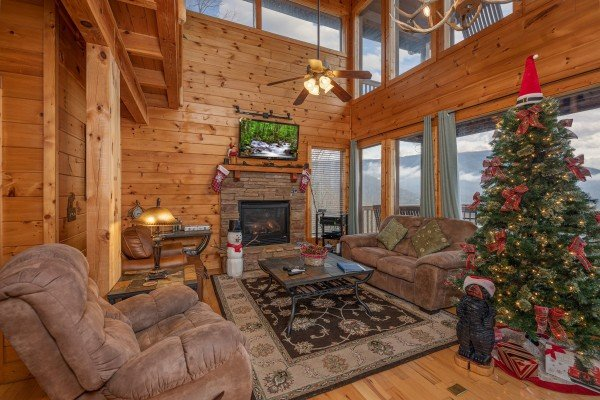 Fireplace, TV, and seating in the living room at 1 Awesome View, a 3 bedroom cabin rental located in Pigeon Forge