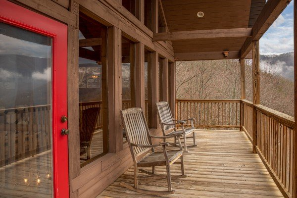 Rocking chairs on the deck at 1 Awesome View, a 3 bedroom rental cabin in Pigeon Forge