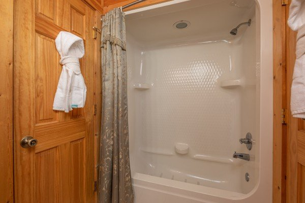 Tub and shower at 1 Awesome View, a 3 bedroom rental cabin in Pigeon Forge
