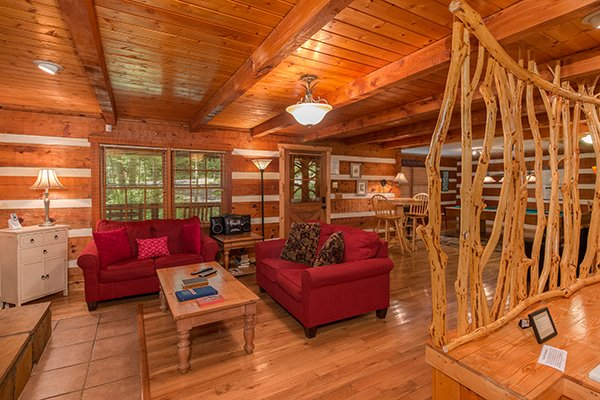 Two twin loveseat sleepers in the living room at Wild at Heart, a 1 bedroom cabin rental located in Gatlinburg