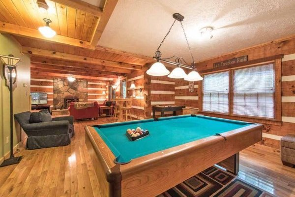 Pool table in the game room at Wild at Heart, a 1 bedroom cabin rental located in Gatlinburg