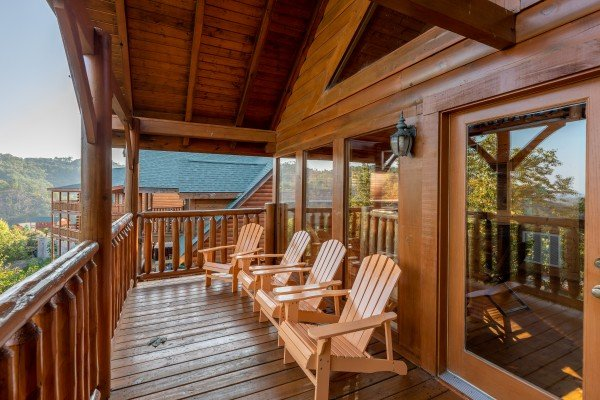 Deck adirondack chairs at Rocky Top Retreat, a 2 bedroom cabin rental located in Pigeon Forge