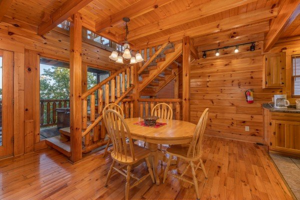 Dining table for four at Rocky Top Retreat, a 2 bedroom cabin rental located in Pigeon Forge