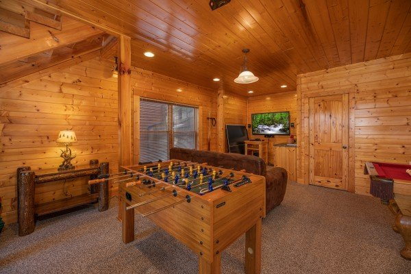 Foosball table in the game room at Rocky Top Retreat, a 2 bedroom cabin rental located in Pigeon Forge