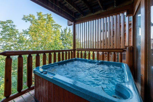 Hot tub with privacy fence at Rocky Top Retreat, a 2 bedroom cabin rental located in Pigeon Forge