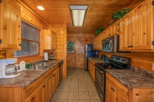 Kitchen with stainless appliances at Rocky Top Retreat, a 2 bedroom cabin rental located in Pigeon Forge