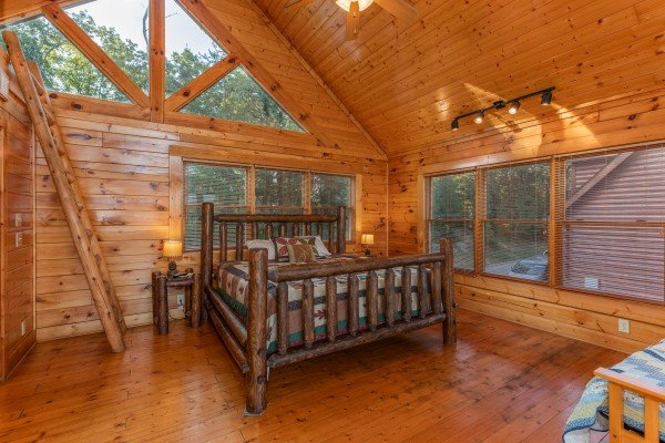 Multiple beds in the loft space at Rocky Top Retreat, a 2 bedroom cabin rental located in Pigeon Forge