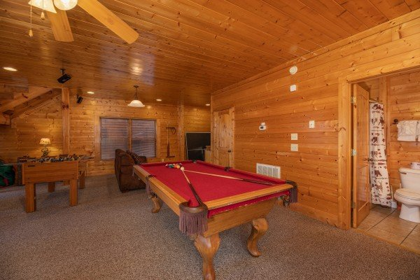 Pool table in the game room at Rocky Top Retreat, a 2 bedroom cabin rental located in Pigeon Forge