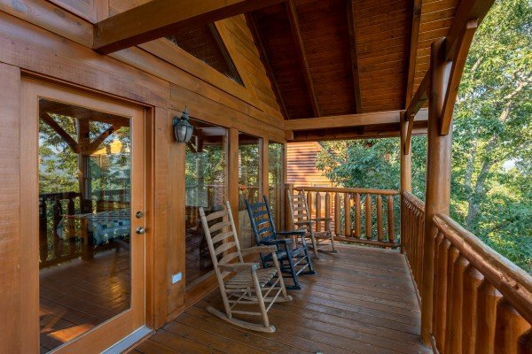 Rocking chairs on the covered deck at Rocky Top Retreat, a 2 bedroom cabin rental located in Pigeon Forge