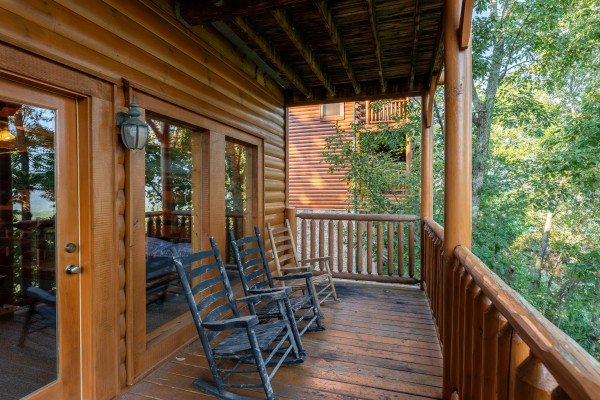 Lower level rocking chairs at Rocky Top Retreat, a 2 bedroom cabin rental located in Pigeon Forge