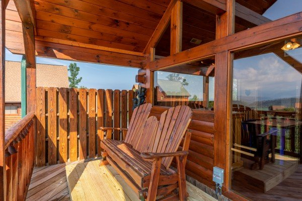 Adirondack bench on the loft deck at 1 Above the Smokies, a 2 bedroom cabin rental located in Pigeon Forge