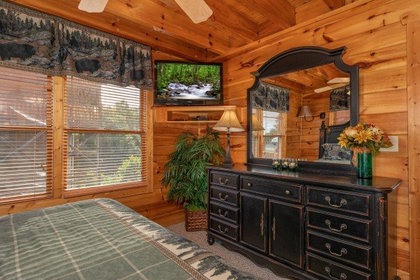 Dresser, mirror, and TV in a bedroom at 1 Above the Smokies, a 2 bedroom cabin rental located in Pigeon Forge