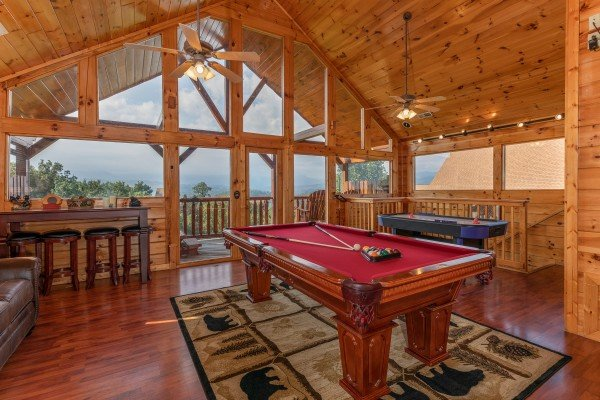 Pool table, bar area, and air hockey table in the loft at 1 Above the Smokies, a 2 bedroom cabin rental located in Pigeon Forge