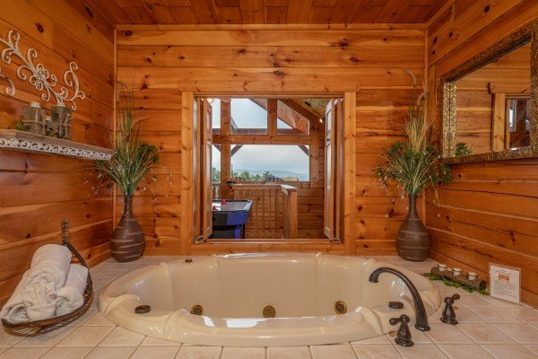 Jacuzzi in a bathroom at 1 Above the Smokies, a 2 bedroom cabin rental located in Pigeon Forge